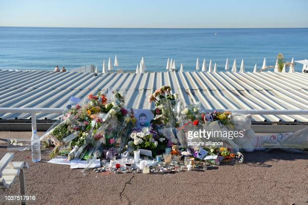 Flowers lie at the spot where a child was killed on Promenade des Anglais in Nice France July 17 2016 when a truck drove into a crowd during Bastille...
