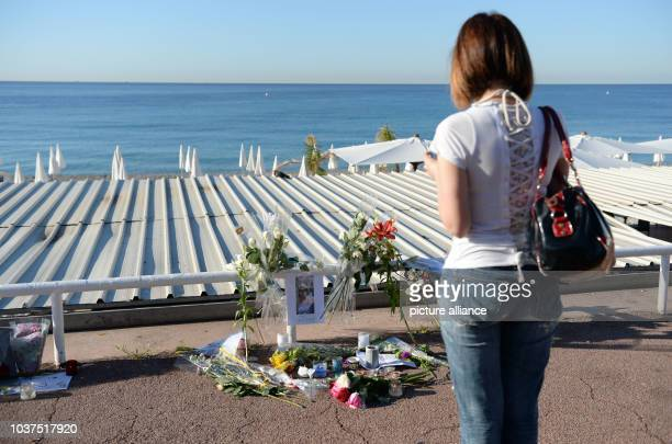 Flowers lie at the spot where a woman was killed on Promenade des Anglais in Nice France July 17 2016 when a truck drove into a crowd during Bastille...