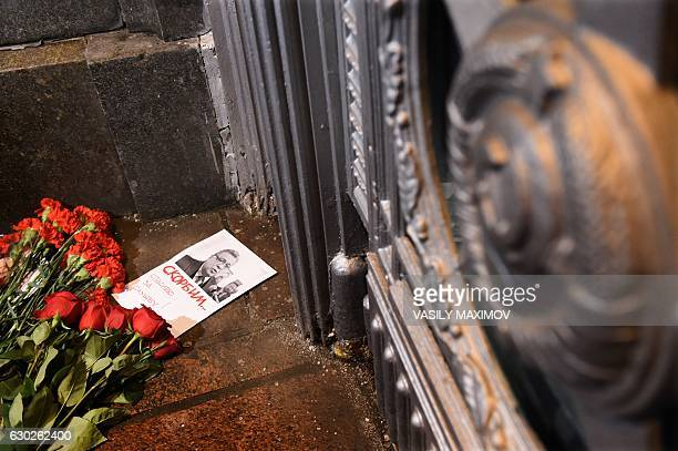Flowers lie next to a picture of Russia's ambassador to Turkey Andrei Karlov outside the Russian foreign ministry in Moscow following his...