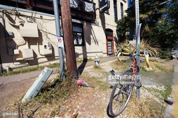 Flowers lie on the ground near the scene of a deadly car accident at the South by Southwest Music Film and Interactive Festival on March 13 2014 in...