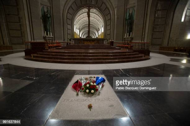 Flowers lie on the tomb of Francisco Franco inside a mausoleum at the Valle de los Caidos on July 4 2018 in San Lorenzo de El Escorial near Madrid...