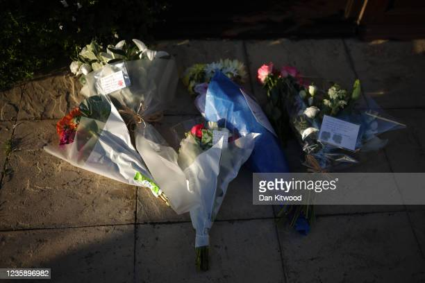 Flowers lie outside Southend West Conservative Association's Iveagh Hall, Sir David Amess' Constituency office address, following the stabbing of UK...