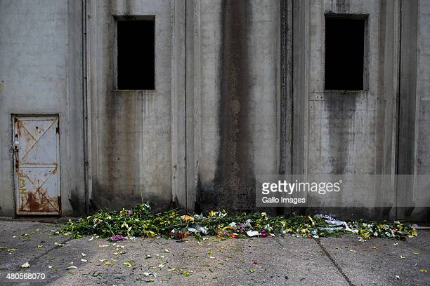 Flowers lies on the ground behind the Dutch Bat III hangar on July 9 2015 at the Srebrenica Potocari Memorial and Cemetery at Potocari Bosnia During...