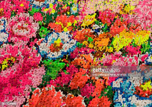 Flowers made by children pixels holding up colored boards during Arirang mass games in may day stadium Pyongan Province Pyongyang North Korea on...