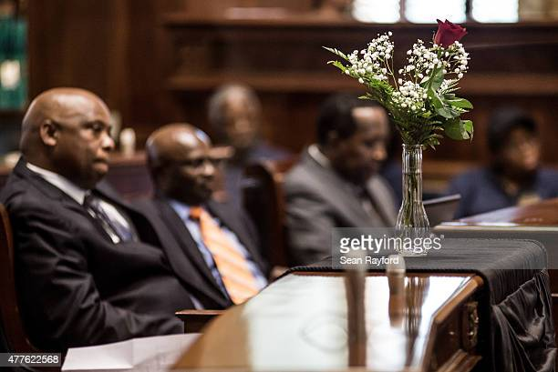 Flowers mark the absence of South Carolina State Senator Clementa Pinckney in the senate chambers June 18 2015 in Columbia South Carolina Legislators...