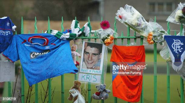 Flowers mark the scene, March 18, 2004 where 15-year-old Kriss Donald was abducted by a gang of five men in the Pollokshields area of Glasgow,...