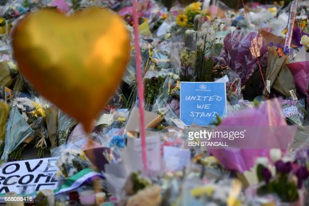Flowers messages and candles are pictured in St Ann's Square in Manchester northwest England on May 25 placed in tribute to the victims of the May 22...