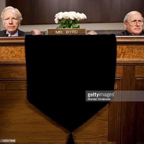 Flowers occupy the seat of US Sen Robert Byrd who died yesterday at the age of 92 as US Sen Joseph Lieberman and committee chairman US Sen Carl Levin...