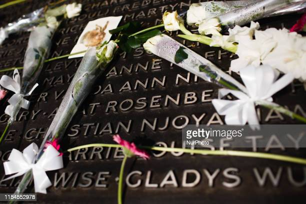 Flowers of condolence left 14 years to the day after the 7/7 bombings lie on a plaque of victims' names at the 7 July Memorial in Hyde Park in London...