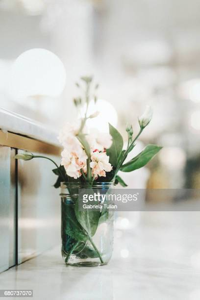 Flowers on a table of empty coffee bar