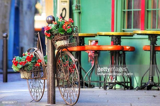 Flowers On Bicycle Basket At Sidewalk Cafe