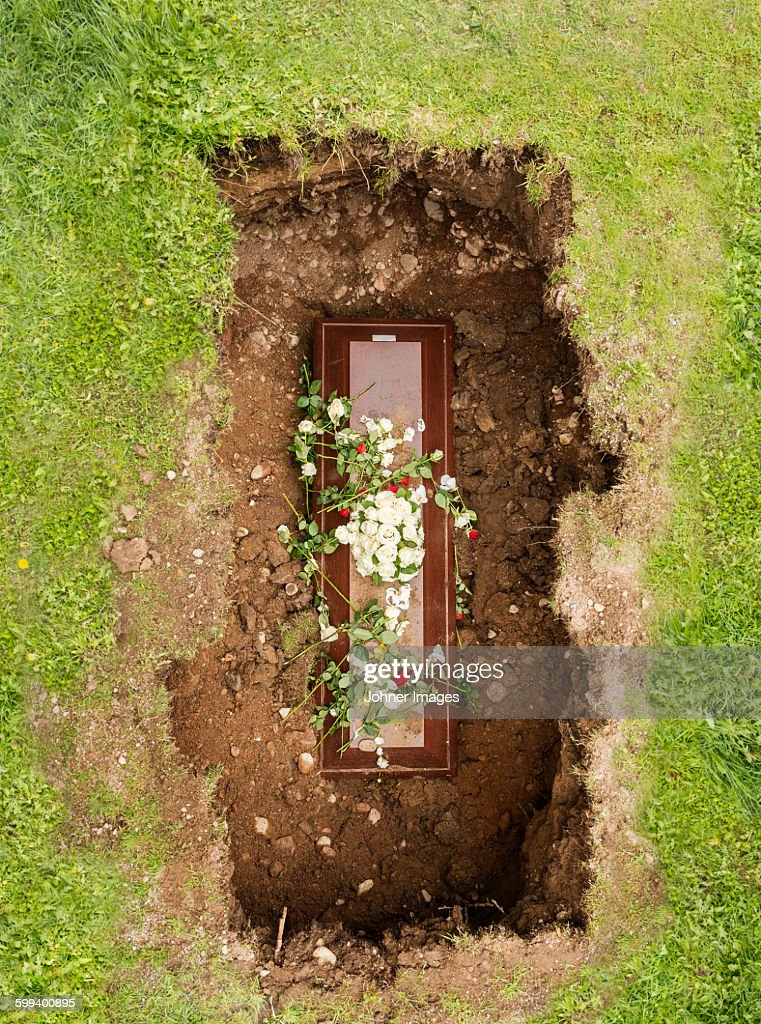 Flowers on coffin : Stock Photo