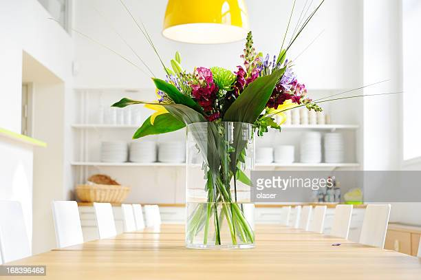 Flowers on table in bright large kitchen