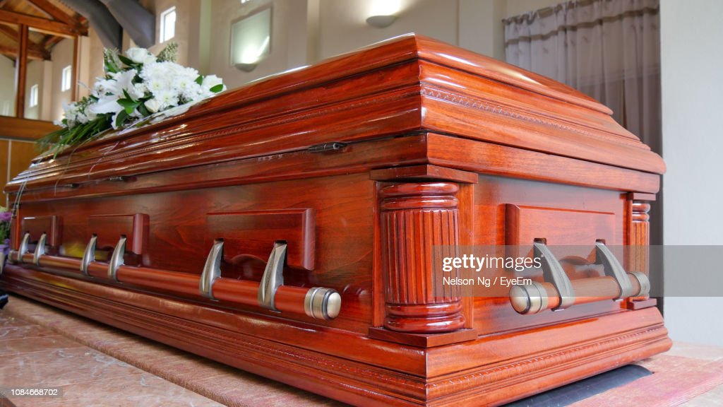 Flowers On Wooden Coffin : Stock Photo