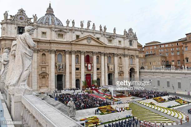 Flowers ornate St Peter's square as Pope Francis celebrates the Easter Sunday mass outside St Peter's Basilica on April 21 2019 in the Vatican...