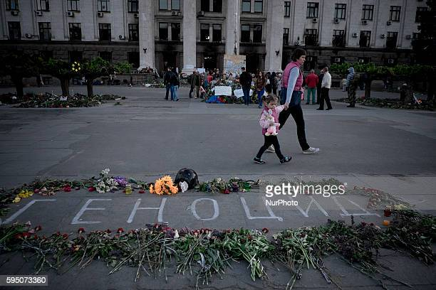 Flowers outside the burnt trade union building in Odessa, Ukraine, Wednesday May 7, 2014. More than 40 people died in the riots, which some from...
