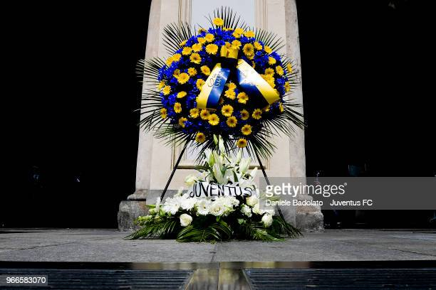 Flowers pays respect to fan Erika Pioletti on June 3, 2018 in Turin, Italy. Juventus fan Erika Pioletti died while watching the 2017 Champions League...