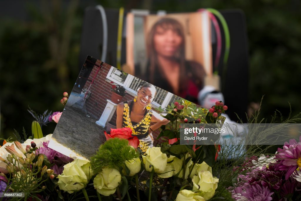Flowers, photos, and other items are placed at a memorial for Charleena Lyles at the apartment building in which she was killed on June 20, 2017 in Seattle, Washington. Officers from the Seattle Police Department shot and killed Lyles, a pregnant mother of four, on June 18.