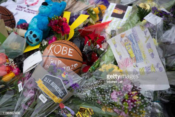 Flowers pictures and notes are left at a memorial for former Los Angeles Laker Kobe Bryant after he was killed in a helicopter crash at Lower Merion...