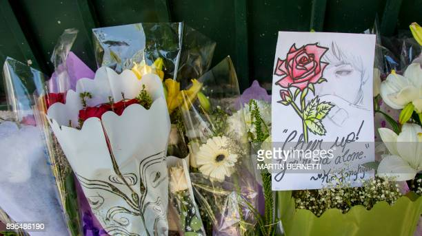Flowers placed by fans of Kim JongHyun a 27yearold lead singer of the massively popular Kpop boyband SHINee are seen outside the South Korean embassy...