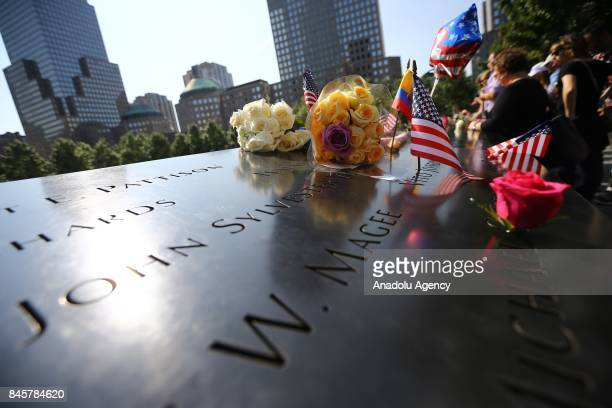 Flowers replaced over the monument for the 9/11 attacks victims on the 16th anniversary of the 9/11 in Ground Zero Manhattan New York United States...
