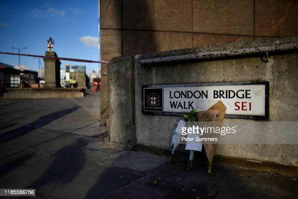 Flowers rest against a wall at the scene of yesterday's London Bridge stabbing attack on November 30 2019 in London England A man and a woman were...