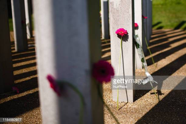 Flowers rest at the base of the 52 stainless steel stelae of the 7 July Memorial pictured 14 years to the day after the 7/7 bombings in Hyde Park in...