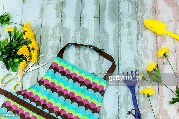 flowers, scissors on a black wooden table