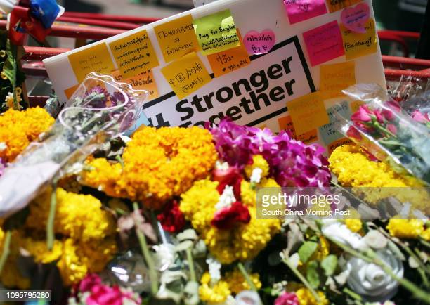 Flowers seen near the site of a blast at the Ratchaprasong intersection in Bangkok, Thailand. 19AUG15