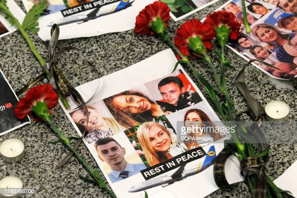 Flowers seen placed on the portraits of the victims of flight PS 752 at the memorial corner of Boryspil International Airport Ukrainian international...