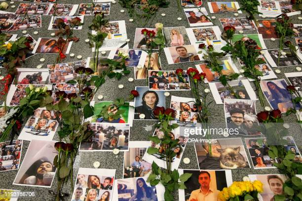 Flowers seen placed on the portraits of the victims of flight PS 752 at the memorial corner of Boryspil International Airport. Ukrainian...