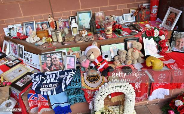 Flowers, shirts and photographs surround the eternal flame of the Hillsborough memorial at Anfield in Liverpool, north west England on April 14 the...
