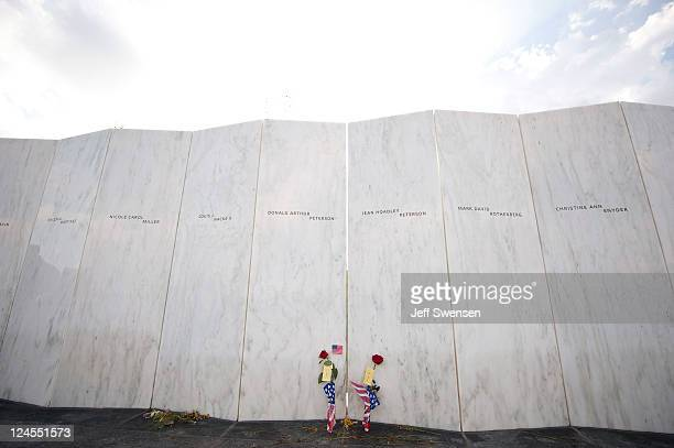 Flowers sit along the Wall of Names at the Flight 93 Memorial for the dedication ceremony September 10 2011 in Shanksville Pennsylvania The Flight 93...