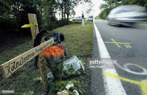 Flowers sit beside a wooden cross at the site of a a fatal accident involving some of Australia's top women cyclists near the town of Gera on July 19...