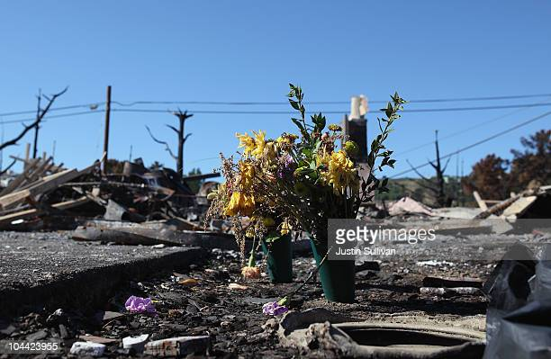 Flowers sit in front of a burned home where two people died near the epicenter of the gas line explosion that devastated a neighborhood near San...