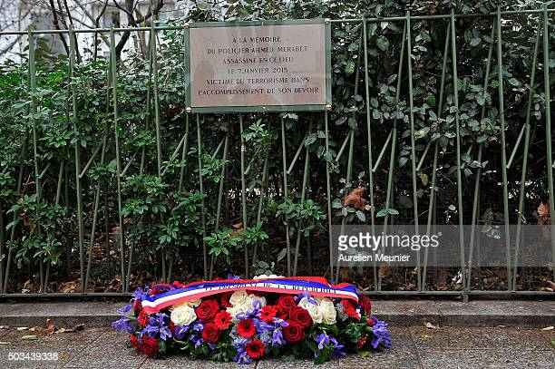 Flowers sit near the memorial stone in tribute to the police Officer Ahmed Merabet stone in next to former Charlie Hebdo office on January 5 2016 in...