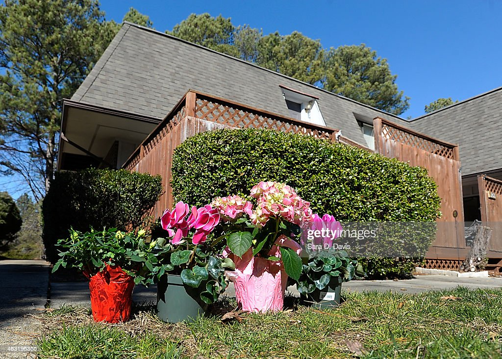 Flowers sit outside the apartments of University of North Carolina dentistry student Deah Shaddy Barakat, 23, his new wife Yusor Mohammad, 21, and her sister Razan Mohammad Abu-Salha, 19, after their alledged murders at the Finley Forest condominium complex on February 11, 2015 in Chapel Hill, North Carolina. Craig Stephen Hicks, 46, was charged with three counts of first-degree murder in the alledged shooting of death of three Muslim Americans near the University of North Carolina at Chapel Hill campus.