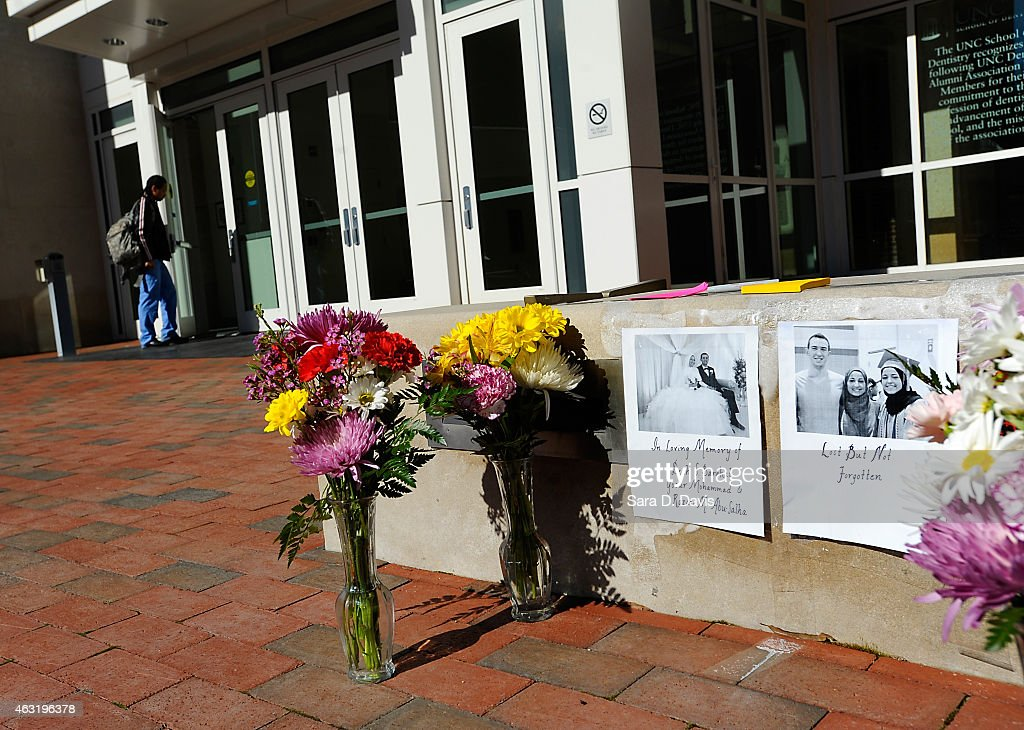 Flowers sit outside the University of North Carolina School of Dentistry in recognition of dentistry student Deah Shaddy Barakat, 23, his new wife Yusor Mohammad, 21, and her sister Razan Mohammad Abu-Salha, 19, February 11, 2015 in Chapel Hill, North Carolina. Barakat, Mohammad and Abu-Salha where shot to death in their the Finley Forest condominium complex alledgedly by their neighbor Craig Stephen Hicks who has been charged with three counts of first degree murder with no bond. Chapel Hill police are investigating motives of a parking space dispute at the complex may have triggered the murders.