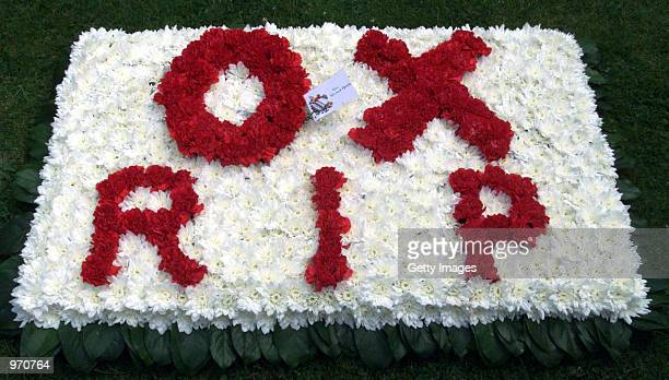 Flowers spelling out OX the nickname for John Entwistle sit outside St Edwards Church for his funeral service July 10 2002 in StowontheWold United...