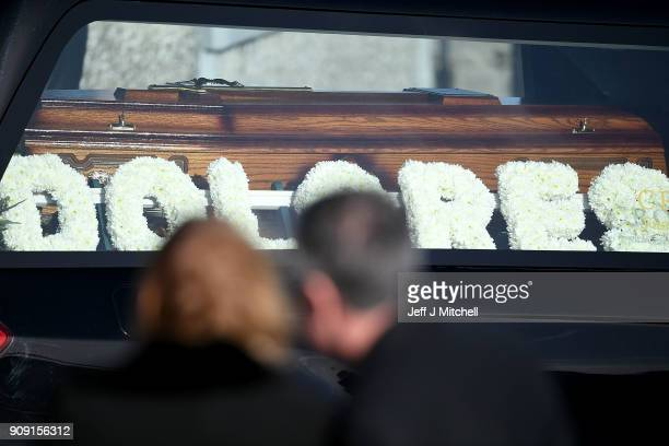 Flowers spelling the name 'Dolores' rest next to the coffin at the funeral of Dolores O'Riordan at St Ailbe's parish church in Ballybricken on...
