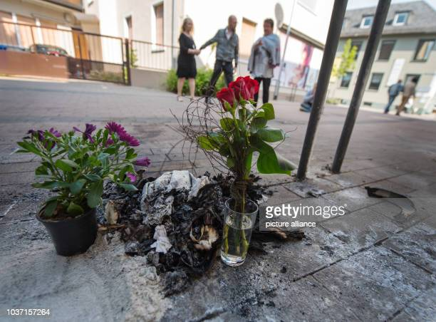 Flowers stand at the site where a homeless man burned to death in GrossGerau Germany 14 April 2017 The homeless man was found burning on the street...