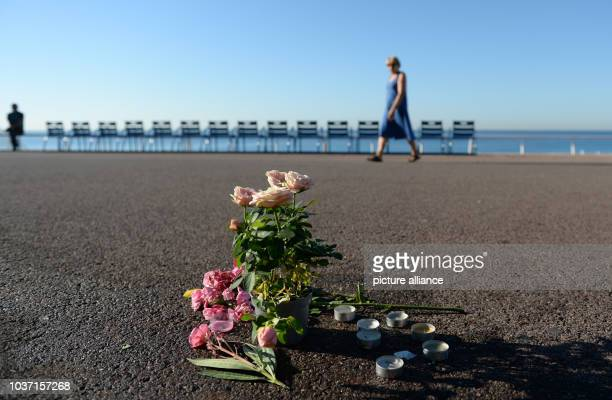 Flowers stand at the spot where someone was killed on Promenade des Anglais in Nice France July 17 when a truck drove into a crowd during Bastille...