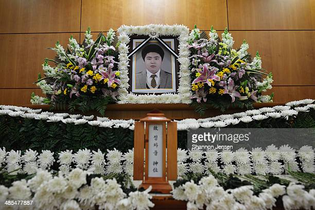 Flowers surround a memorial for Chung Cha Ung at a funeral home on April 18 2014 in Ansan South Korea Chung a second year student from Danwon High...