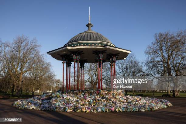Flowers surround the Clapham Common bandstand memorial to murdered Sarah Everard on March 27, 2021 in London, England. Sarah Everard, a 33-year-old...