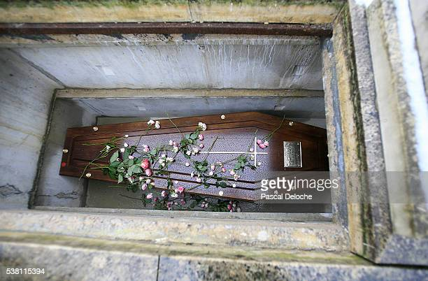 Flowers Upon a Coffin During a Burial