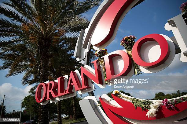 Flowers were placed on a sign outside the Orlando Health Medical Center on South Orange Avenue down the street from Pulse Nightclub June 13 2016 in...