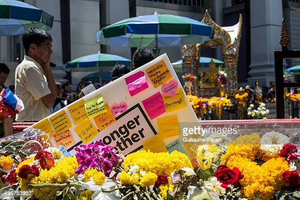 Flowers with messages are laid outside the reopened Erawan Shrine in Central Bangkok on August 19th 2015, after a bomb exploded outside this shrine...