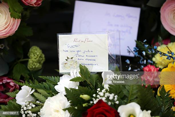 Flowers with messages of condolence lay beneath a memorial stone after a service for the murdered Police woman Yvonne Fletcher in St James' Square on...