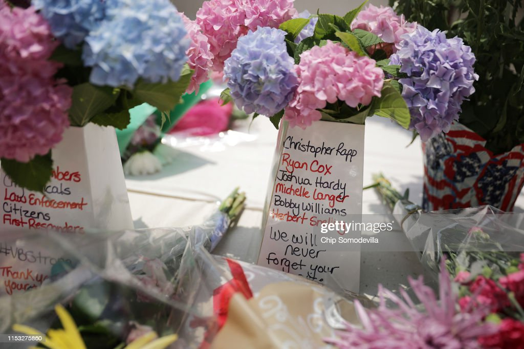 Flowers With The Names Of The Victims Of A Mass Shooting Are Left