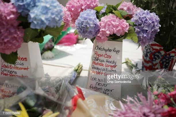 Flowers with the names of the victims of a mass shooting are left at a makeshift memorial at the Municipal Center June 02 2019 in Virginia Beach...
